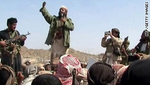 A man claiming to be an al Qaeda member addresses a crowd gathered in southern Yemen on Dec 22.
