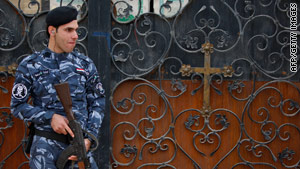 A security officer stands guard Friday at a Baghdad church.