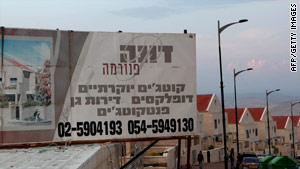A billboard promotes a new housing project in the West Bank settlement of Ma'ale Adumin.