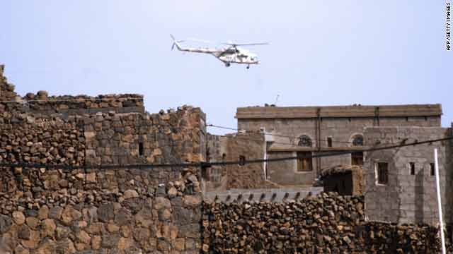 A Yemeni army helicopter carries out operations against al Qaeda suspects on December 17 in the Sanaa province.