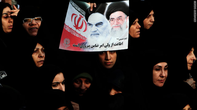 Iranian women attend a pro-government rally Wednesday in Tehran with a poster showing Aayatollahs Khomeini and Khameini.