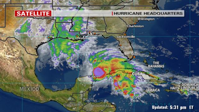 http://i.cdn.turner.com/cnn/2009/WORLD/weather/11/08/tropical.storm.ida/t1larg.ida.sun.1800.jpg