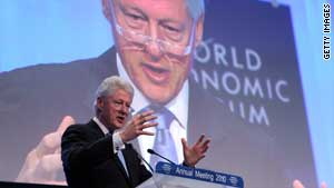 Clinton calls for more Haiti aid at Davos