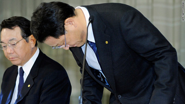 Akio Toyoda, president of Toyota Motor Co., bows in apology at Tuesday's press conference announcing another global recall.
