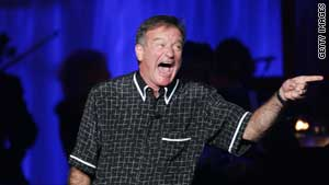 Comic improviser Robin Williams performing on stage. Improvisation is being taught at some business schools.
