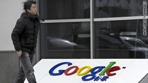 A man walks past the company logo in front of the Google China headquarters building in Beijing on January 20, 2010.