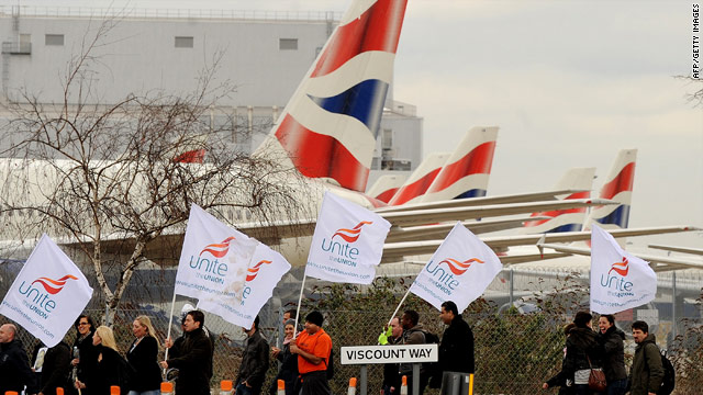 Striking BA cabin crew walk past grounded aircraft on the final day of a three-day strike near Heathrow airport.