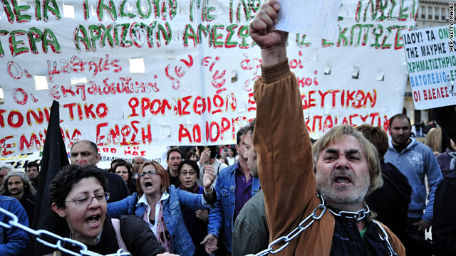 Demonstrators protest against government austerity measures outside the Greek Parliament in Athens on Tuesday.