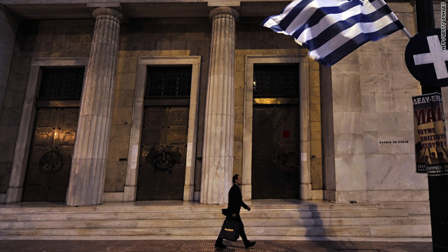 A man walks outside the headquarters of Greece's central bank. The country is seeking an EU/IMF-funded bailout.