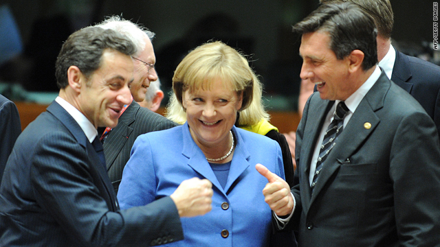 French President Nicolas Sarkozy, left, German Chancellor Angela Merkel and Sloven Prime Minister Borut Pahor gesture prior to a working session of an European Union summit at the European Council headquarters on March 25, 2010 in Brussels.