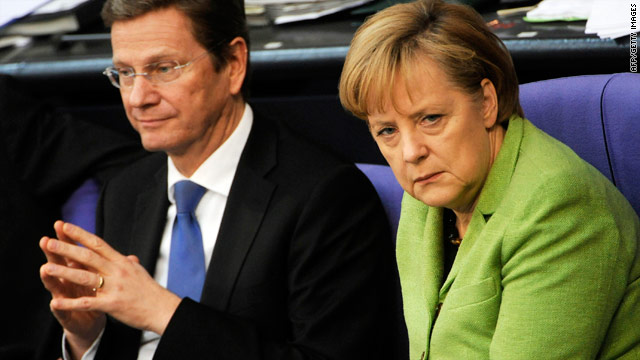 German Chancellor Angela Merkel with Finance Minister Guido Westerwelle in the German parliament on Friday.