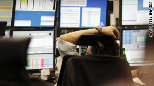 A bank trader slumps in his chair during the trading day at Germany's stock exchange in Frankfurt on May 10, 2010.