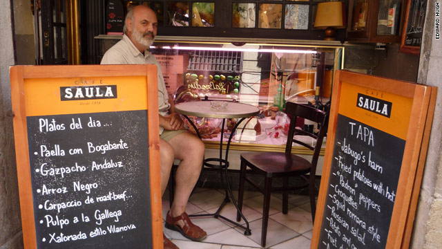 Edward Hugh sits in a cafe near his home in Spain where the British expat has been living since 1990.