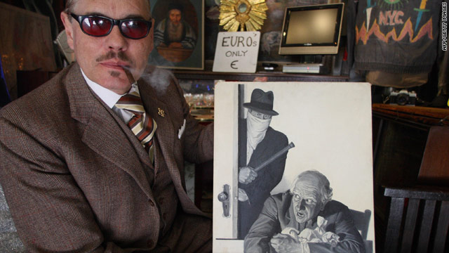 "Billy Leroy, owner of Billy's Antiques & Props in Manhattan, caused a media sensation when he hung his ""Euro's Only"" sign, as pictured here in 2008. Now the sign is down and euros are out, Leroy said."