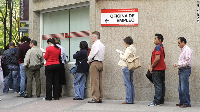 People wait in line at a government employment office in the center of Madrid on April 30, 2010.