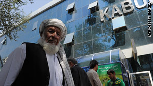 Afghan men wait to withdraw money from the Kabul Bank in Kabul on Thursday.