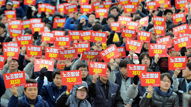Labour union members from the Korean Confederation of Trade Unions at a rally against the government in Seoul last March.