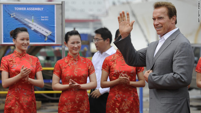 California Governor Arnold Schwarzenegger waves during his visit to the Zhenhua Port Machinery Company in Shanghai on September 13.