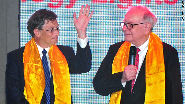 Wearing gift Tibet scarves, U.S. business leader Warren Buffett, right, and  fellow billionaire Bill Gates in China on September 29.
