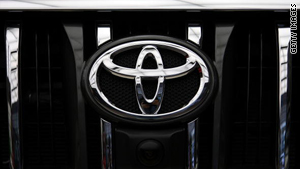 Toyota's logo is seen on the front grille of a car.