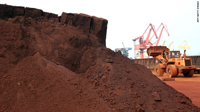 A man driving a front loader shifts soil containing rare earth minerals to be loaded at a port in Lianyungang, east China's Jiangsu province, in September.
