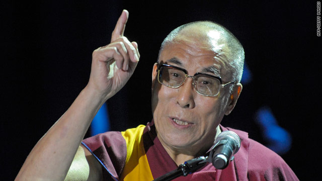 Exiled Tibetan spiritual leader the Dalai Lama gestures during his meeting with 6000 people gathered to see him in Poland on September 22. German researchers found that when heads of state meet with the exiled spiritual leader, exports to China drop.