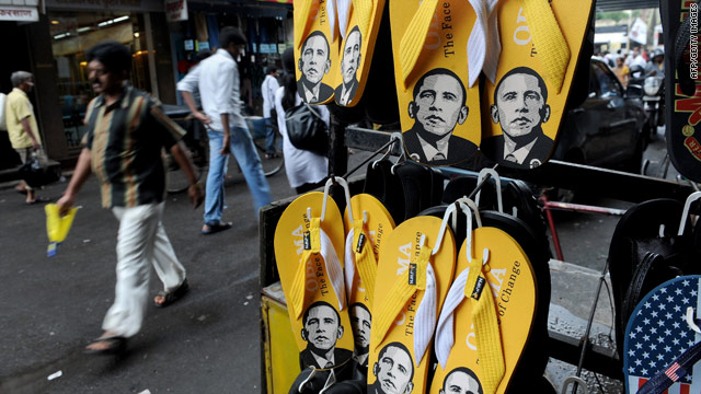 Flip-flops featuring the image of U.S. President Barrack Obama are displayed outside a shoe store in Mumbai.