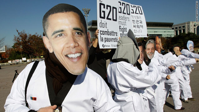 Anti-G20 activists from Oxfam wear masks depicting the G-20 leaders during a rally on November 10.