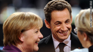 France's President Nicolas Sarkozy, center, and Germany's Chancellor Angela Merkel, left.