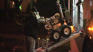 Police used a robot to remove explosives from John D. Raymond's Spokane Valley, Washington, apartment.