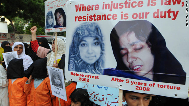 Pakistanis carry posters of Aafia Siddiqui in a demonstration in Karachi in 2008.