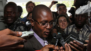 Edwin Coq, who represented 10 Americans detained in Haiti, speaks to reporters about the case last week.