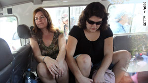Americans Laura Silsby, left, and Charisa Coulter leave a court hearing in Port-au-Prince last week.