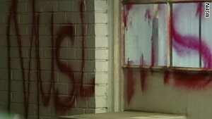 Part of the anti-Muslim message found spray-painted on the front of the Al-Farooq Islamic Center in Nashville, Tennessee.