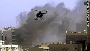 A Blackwater copter hovers over a Baghdad bomb site in 2005. The firm had 1,000 contractors in Iraq at one point.
