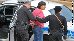 Amy Bishop was taken into custody Friday in the shooting of three people at the University of Alabama in Huntsville.