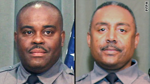 Officers Marvin Carraway, left, and Jeffrey Amos were treated for their wounds at a hospital and released.