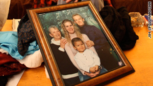 A family photo shows Jamie Pauln-Ramirez with her son, mother and stepfather.