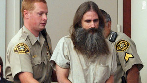 Brian David Mitchell is escorted into court in Salt Lake City, Utah, in July 2005.