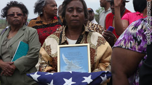 Dorothy Williams was presented an American flag in honor of her father, Isadore Banks.