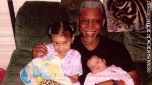 Longtime IRS worker Vernon Hunter, pictured here with his grandchildren in 2009, died in the attack.