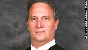 Judge Stan Strickland removed himself from Casey Anthony's murder trial, which has been reassigned.
