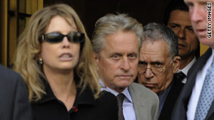 Michael Douglas and ex-wife Diandra Luker leave federal court in New York on Tuesday after their son's sentencing.