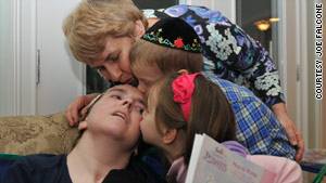 Abbie Dorn is kissed by her mother, Susan Cohen, and  nephew and niece,  Mani and Esti.