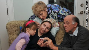 In this photo, with her parents and niece, Esti, Abbie Dorn seems aware of what is happening around her.