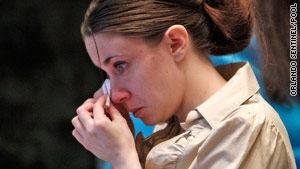Casey Anthony teared up in court when her lawyer said her slain daughter had been happy and healthy.