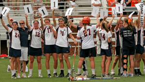 After Sunday's game, Yeardley Love's lacrosse teammates emerge from huddle holding signs with her jersey number.