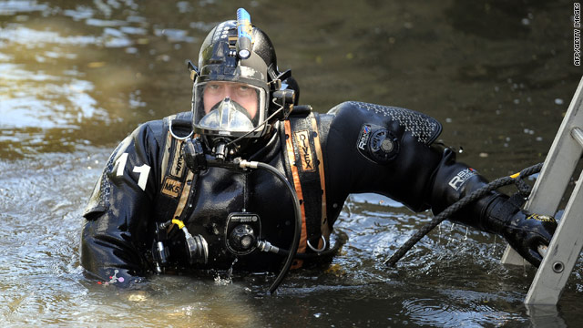 A police diver searches the river Aire on Friday for evidence in the killings of three prostitutes in northern England.