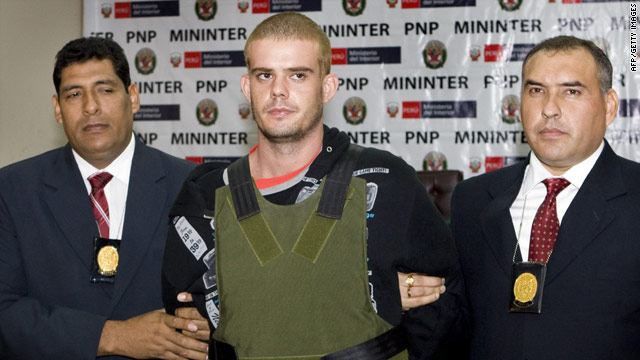 Joran van der Sloot is escorted by Peruvian police in Lima, Peru, on Saturday.