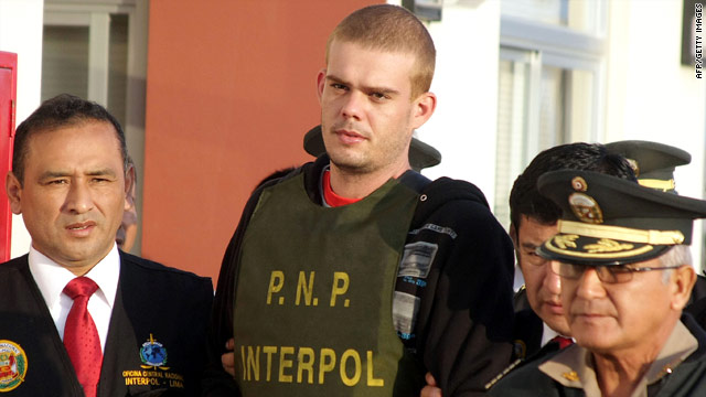 Joran van der Sloot, shown being escorted to a Peruvian jail, has confessed to killing a young woman, police say.